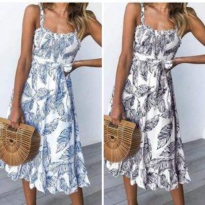 Dresses & Skirts - Blue leaf print dress